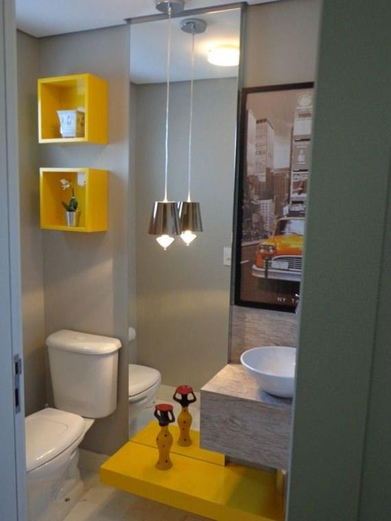 lavabo em tons de amarelo decorado com pendente