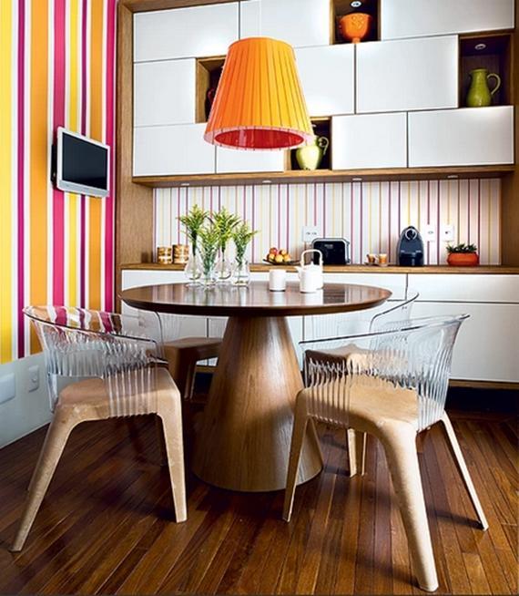 sala de jantar com mesa e pendente redondos